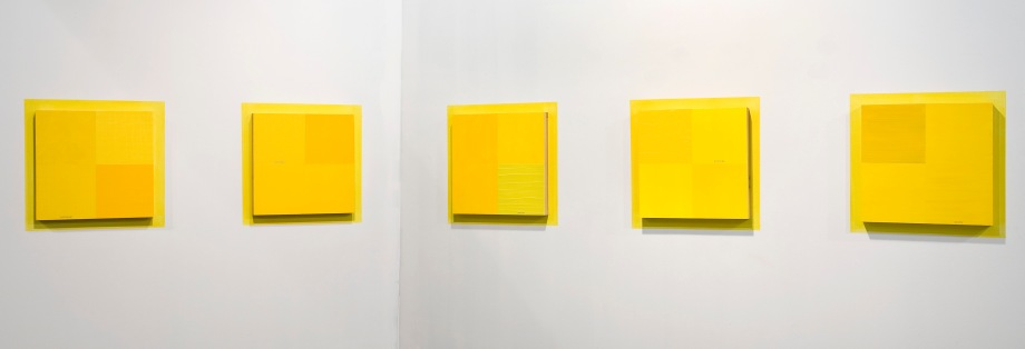 "The Logic of Ambiguity / The Ambiguity of Logic (2001), an installation set of 5-16"" x 16"" acrylic on plywood panels with vinyl text on painted wall"