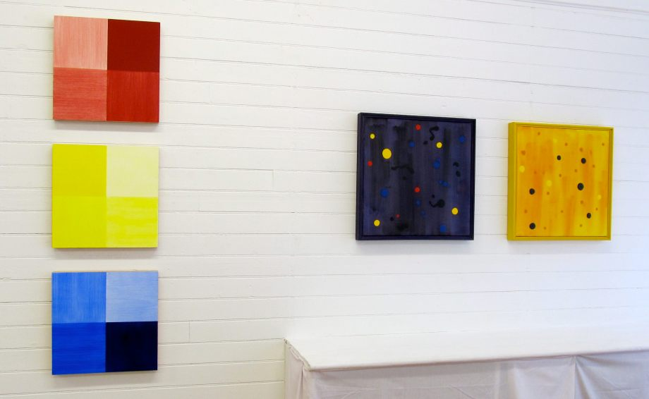 "From left - ABC (1999), acrylic on panel, 16"" x 16"" each, and Dark Energy (2002), acrylic on canvas, 20"" x 20"", and Starry Night Yellow (2002), acrylic on canvas, 20"" x 20"""